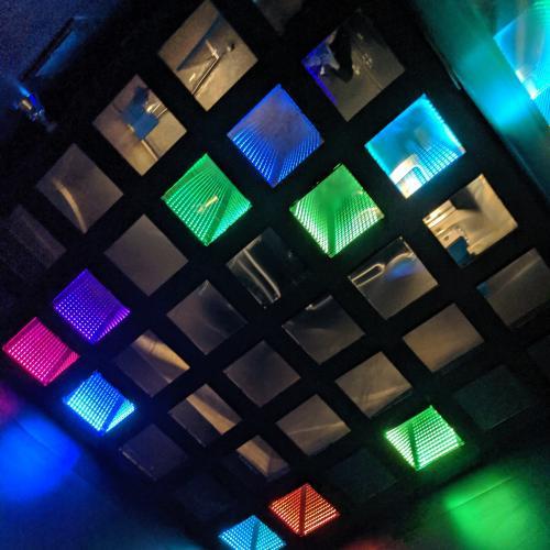 The Ground Kontrol bathroom's light show ceiling.